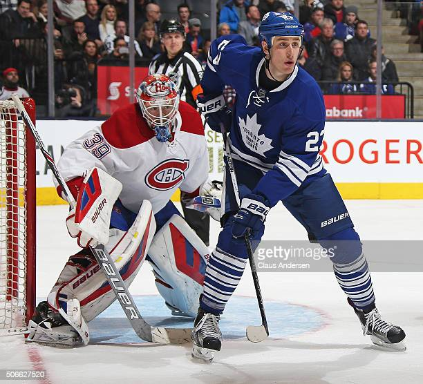Mike Condon of the Montreal Canadiens looks around a screening Shawn Matthias of the Toronto Maple Leafs during an NHL game at the Air Canada Centre...