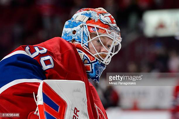 Mike Condon of the Montreal Canadiens looks on during the warmup period prior to NHL game against the New York Rangers at the Bell Centre on March 26...