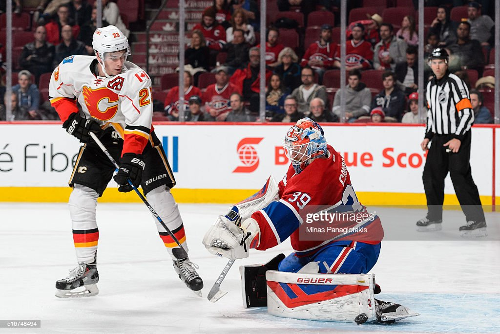 Mike Condon #39 of the Montreal Canadiens makes a pad save near Sean Monahan #23 of the Calgary Flames during the NHL game at the Bell Centre on March 20, 2016 in Montreal, Quebec, Canada. The Calgary Flames defeated the Montreal Canadiens 4-1.