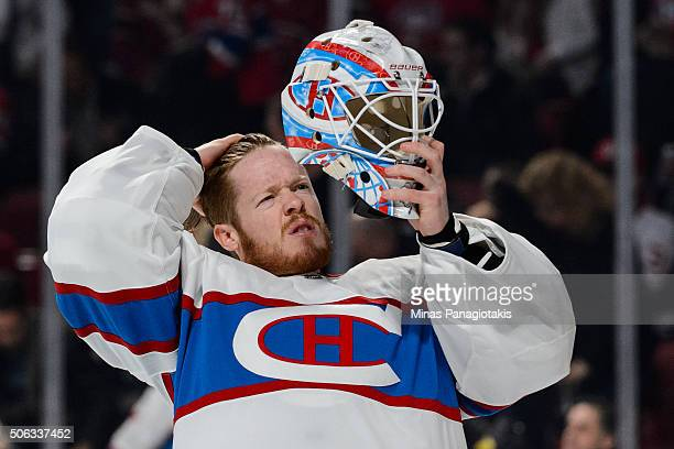 Mike Condon of the Montreal Canadiens prepares to put on his goalie mask during the NHL game against the Boston Bruins at the Bell Centre on January...