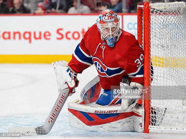 Mike Condon of the Montreal Canadiens protects his net during the NHL game against the Calgary Flames at the Bell Centre on March 20 2016 in Montreal...