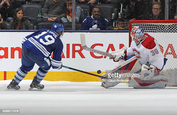 Mike Condon of the Montreal Canadiens turns away Joffrey Lupul of the Toronto Maple Leafs during an NHL game at the Air Canada Centre on January...
