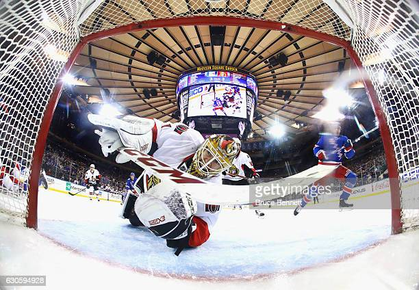 Mike Condon of the Ottawa Senators looks in the net as the game winning goal goes in off the stick of Nick Holden of the New York Rangers at 631 of...
