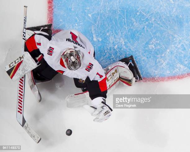 Mike Condon of the Ottawa Senators makes a glove save against the Detroit Red Wings during an NHL game at Little Caesars Arena on March 31 2018 in...