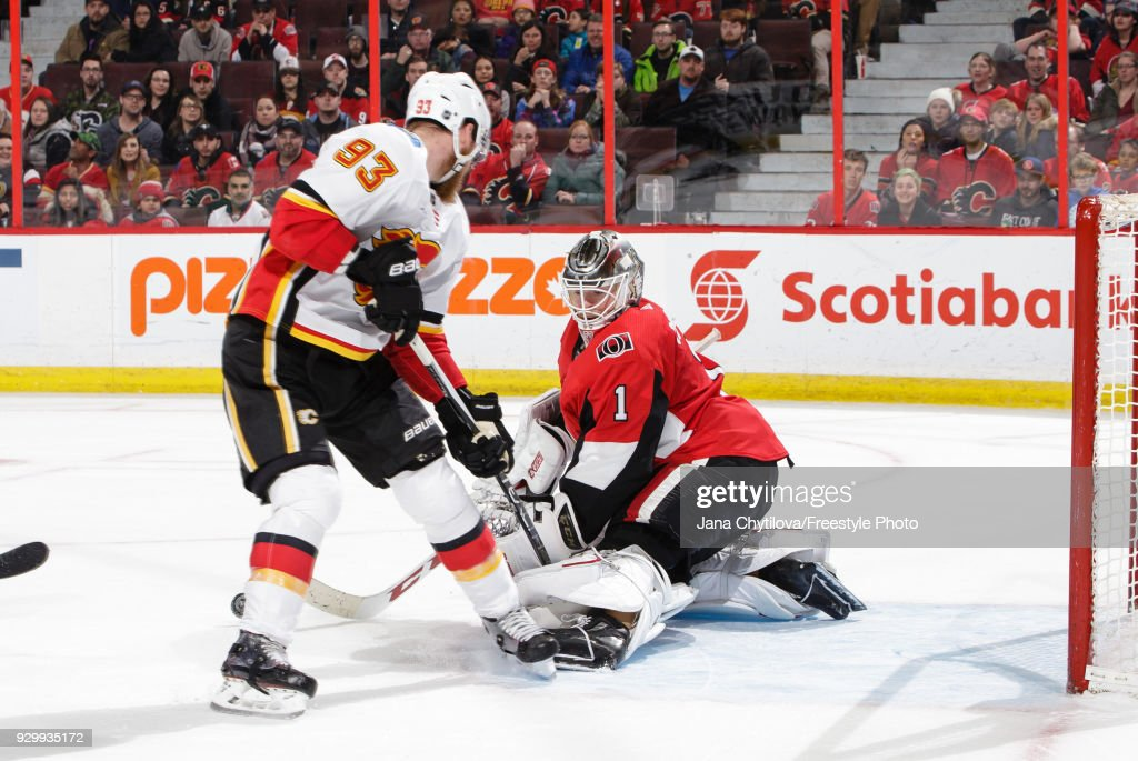 Mike Condon #1 of the Ottawa Senators makes a pad save against Sam Bennett #93 of the Calgary Flames in the third period at Canadian Tire Centre on March 9, 2018 in Ottawa, Ontario, Canada.