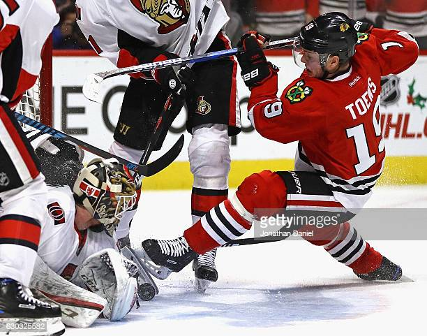 Mike Condon of the Ottawa Senators makes a save against Jonathan Toews of the Chicago Blackhawks at the United Center on December 20 2016 in Chicago...