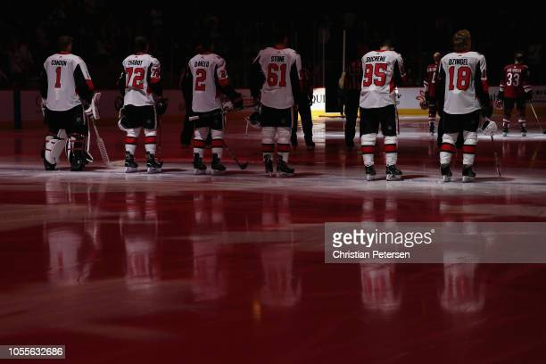 Mike Condon Thomas Chabot Dylan DeMelo Mark Stone Matt Duchene and Ryan Dzingel of the Ottawa Senators stand attended for the Canadien national...