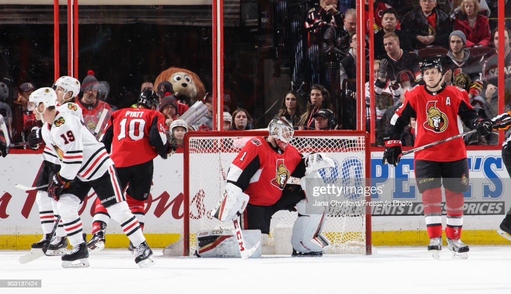 Mike Condon #1, Tom Pyatt #10 and Dion Phaneuf #2 of the Ottawa Senators react after Nick Schmaltz #8 of the Chicago Blackhawks (not pictured) scores a second period power-play goal at Canadian Tire Centre on January 9, 2018 in Ottawa, Ontario, Canada.