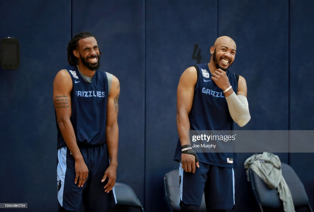 1617267a4 Mike Conley and Jevon Carter of the Memphis Grizzlies smile and ...
