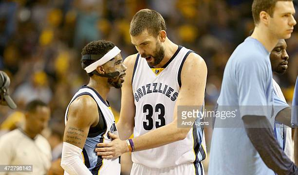 Mike Conley and Marc Gasol of the Memphis Grizzlies celebrate against the Golden State Warriors during Game three of the Western Conference...