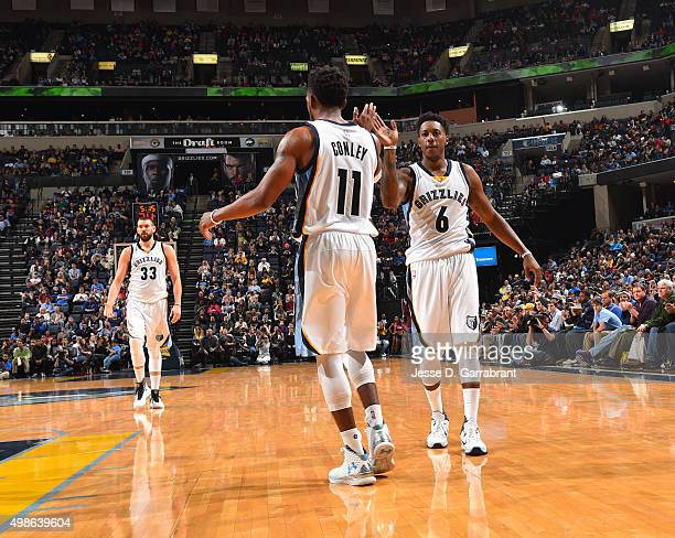 Mike Conley and Mario Chalmers of the Memphis Grizzlies give each other high fives during the game against the Dallas Mavericks on November 24 2015...