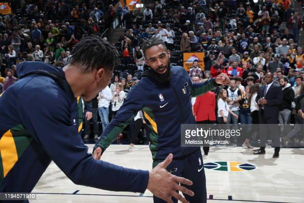 Mike Conley and Rayjon Tucker of the Utah Jazz hifive prior to a game against the Sacramento Kings on January 18 2020 at vivintSmartHome Arena in...
