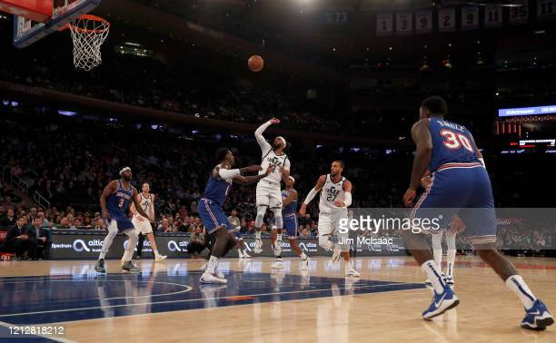 Mike Conley and Rudy Gobert of the Utah Jazz in action against Bobby Portis of the New York Knicks at Madison Square Garden on March 04 2020 in New...