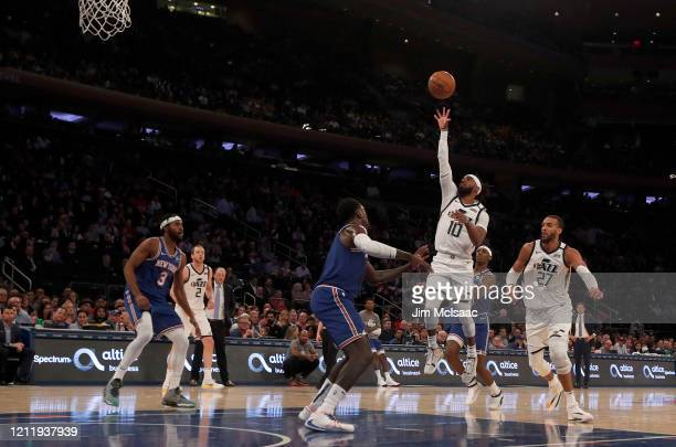 Mike Conley and Rudy Gobert of the Utah Jazz in action against the New York Knicks at Madison Square Garden on March 04 2020 in New York City The...