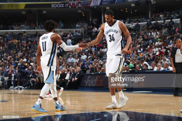 Mike Conley high fives Brandan Wright of the Memphis Grizzlies during the game against the New Orleans Pelicans during the 201718 regular season game...