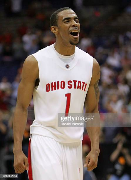 Mike Conley Jr #1 of the Ohio State Buckeyes celebrates after Ohio Stae's 9276 win against the Memphis Tigers during the south regional final of the...