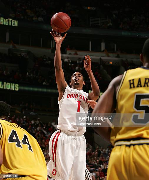 Mike Conley Jr #1 of the Ohio State Buckeyes drives for a shot attempt against the Michigan Wolverines during the quarterfinals of the Big Ten Men's...