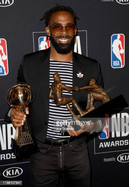 Mike Conley Jr., winner of the NBA Twyman-Stokes Teammate of the Year Award and NBA Sportsmanship Award, poses in the press room during the 2019 NBA...