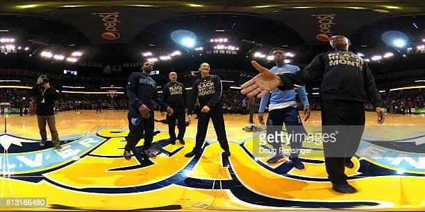 Mike Conley of the Memphis Grizzlies and Emmanuel Mudiay of the Denver Nuggets meet with referees Scott Wall Lauren Holtkamp and Rodney Mott prior to...