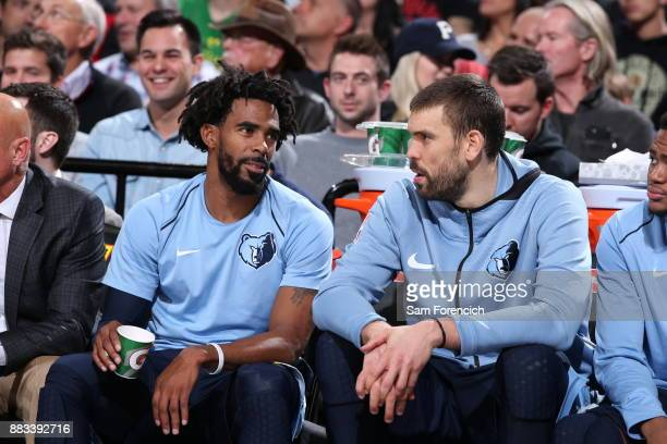 Mike Conley of the Memphis Grizzlies and Marc Gasol of the Memphis Grizzlies speak during the game against the Portland Trail Blazers on November 7...