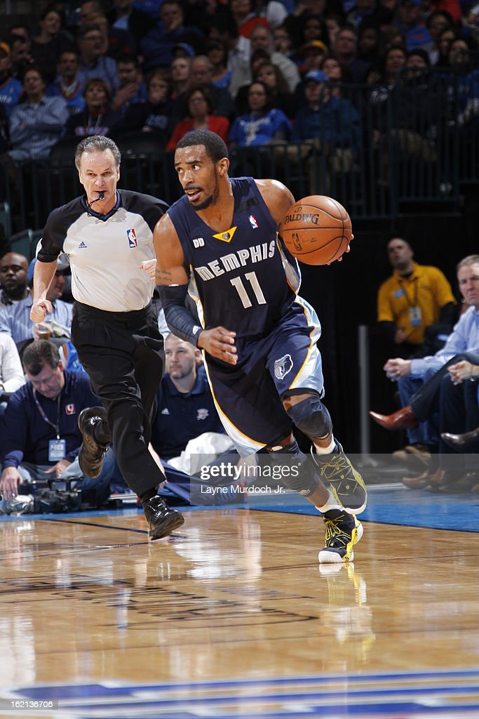 Mike Conley #11 of the Memphis Grizzlies brings the ball up court against the Oklahoma City Thunder on January 31, 2013 at the Chesapeake Energy Arena in Oklahoma City, Oklahoma.