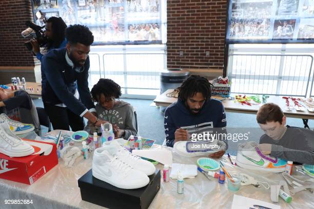Mike Conley of the Memphis Grizzlies design sneakers with patients of St Jude Children's Research Hospital as a part of 'Hoops for St Jude' on March...