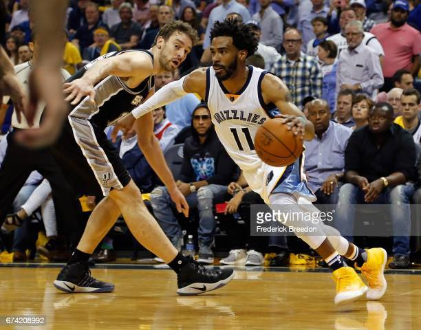 Mike Conley of the Memphis Grizzlies dribbles past Pau Gasol of the San Antonio Spurs during the first half of Game 6 of the Western Conference...