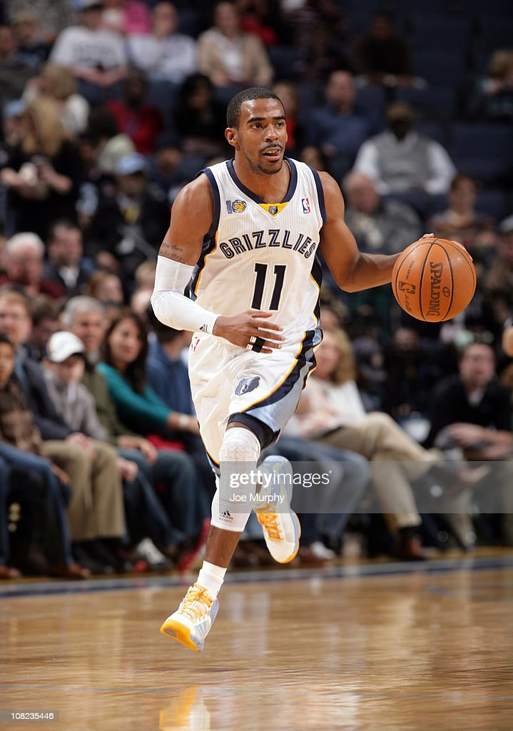 Mike Conley #11 of the Memphis Grizzlies dribbles up the court against the Houston Rockets on January 21, 2011 at FedExForum in Memphis, Tennessee.