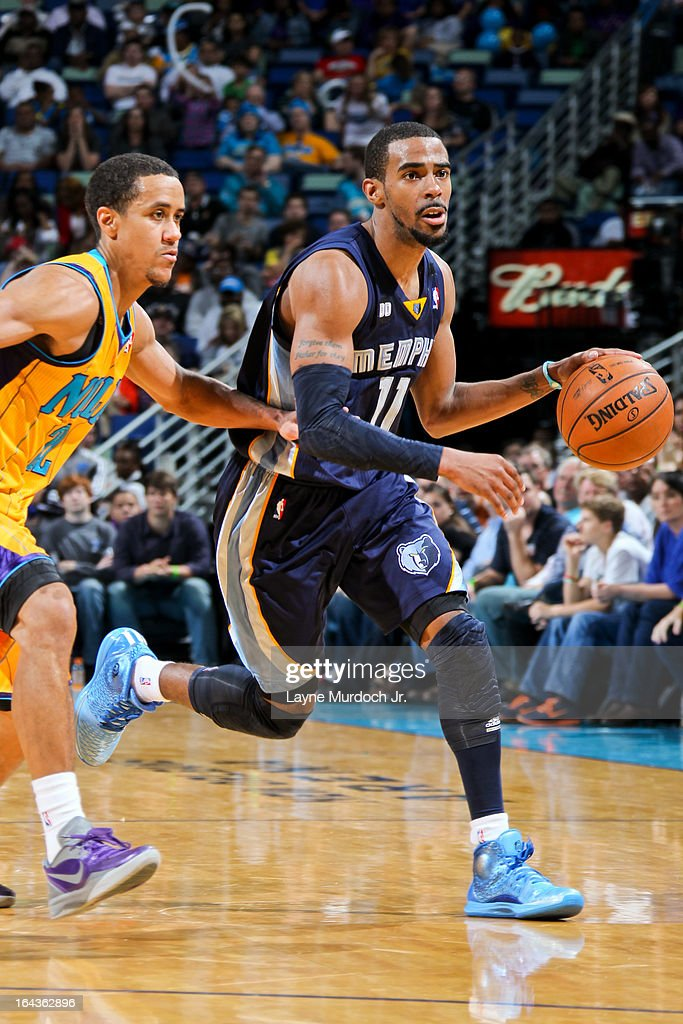 Mike Conley #11 of the Memphis Grizzlies drives against Brian Roberts #22 of the New Orleans Hornets on March 22, 2013 at the New Orleans Arena in New Orleans, Louisiana.