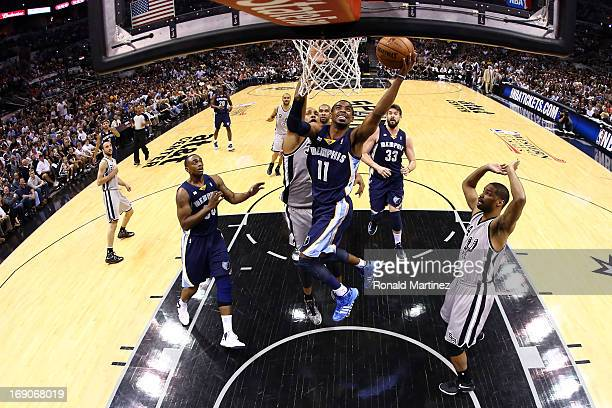 Mike Conley of the Memphis Grizzlies drives for a shot attempt against Boris Diaw of the San Antonio Spurs in the first half during Game One of the...