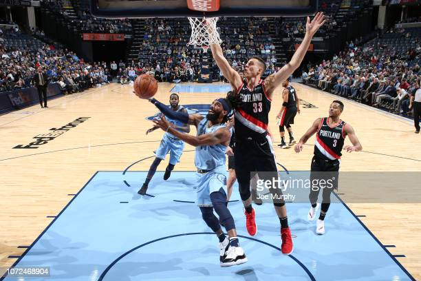 Mike Conley of the Memphis Grizzlies drives to the basket against Zach Collins of the Portland Trail Blazers on December 12 2018 at FedExForum in...