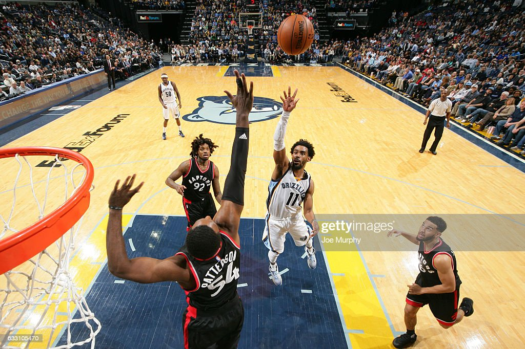 Mike Conley #11 of the Memphis Grizzlies drives to the basket and shoots the ball against the Toronto Raptors on January 25, 2017 at FedExForum in Memphis, Tennessee.