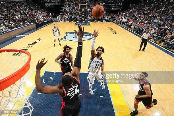Mike Conley of the Memphis Grizzlies drives to the basket and shoots the ball against the Toronto Raptors on January 25 2017 at FedExForum in Memphis...