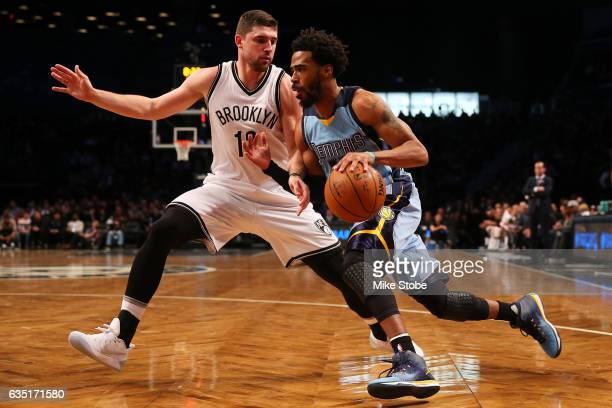 Mike Conley of the Memphis Grizzlies drives to the net against Joe Harris of the Brooklyn Nets at Barclays Center on February 13 2017 in Brooklyn...