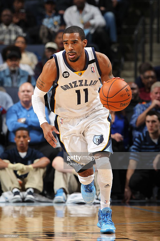 Mike Conley #11 of the Memphis Grizzlies drives up-court against the Oklahoma City Thunder on March 20, 2013 at FedExForum in Memphis, Tennessee.