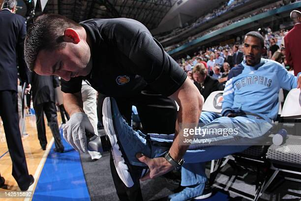 Mike Conley of the Memphis Grizzlies gets Court Grip applied to his sneakers prior to the game against the Dallas Mavericks on April 4 2012 at...