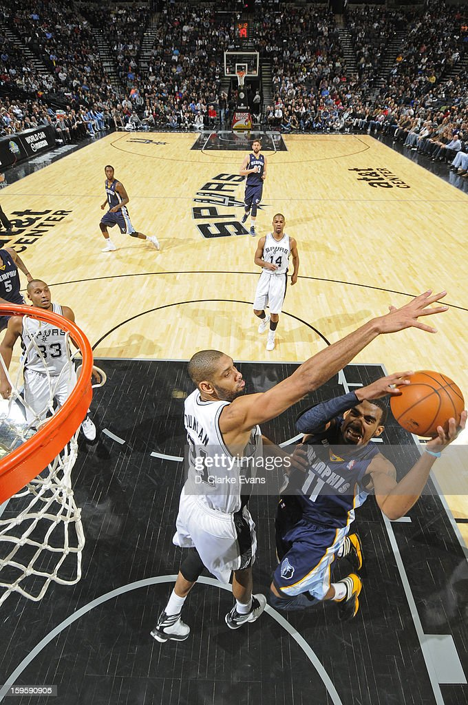 Mike Conley #11 of the Memphis Grizzlies goes to the basket against Tim Duncan #21 of the San Antonio Spurs on January 16, 2013 at the AT&T Center in San Antonio, Texas.