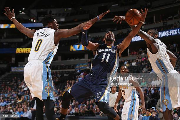 Mike Conley of the Memphis Grizzlies goes up for a shot and is fouled by Emmanuel Mudiay of the Denver Nuggets at Pepsi Center on February 29 2016 in...