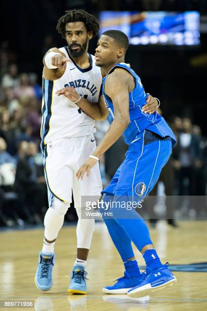 Mike Conley of the Memphis Grizzlies guards Dennis Smith Jr #1 of the Dallas Mavericks at the FedEx Forum on October 26 2017 in Memphis Tennessee...