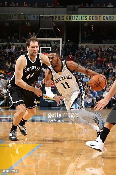 Mike Conley of the Memphis Grizzlies handles the ball against Bojan Bogdanovic of the Brooklyn Nets on February 10 2015 at FedExForum in Memphis...