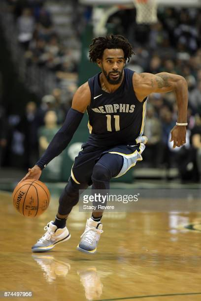 Mike Conley of the Memphis Grizzlies handles the ball during a game against the Milwaukee Bucks at the Bradley Center on November 13 2017 in...