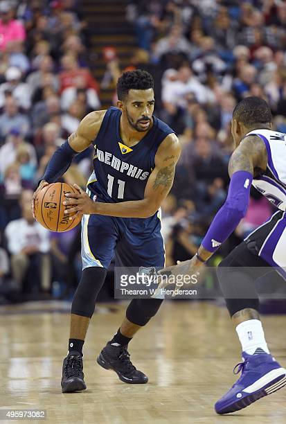 575bf217c Mike Conley of the Memphis Grizzlies looks to put a move on Ben McLemore of  the