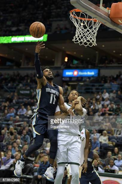 Mike Conley of the Memphis Grizzlies loses the ball while driving against John Henson of the Milwaukee Bucks during the second half of a game at the...