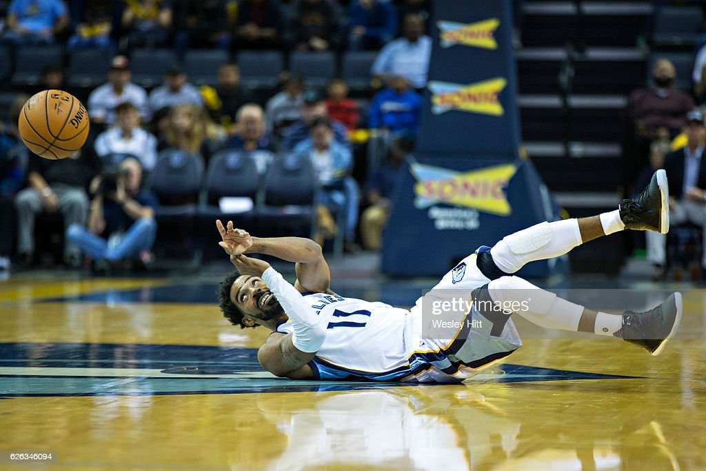 Mike Conley #11 of the Memphis Grizzlies makes a pass from his back during the first half of a game against the Charlotte Hornets at the FedExForum on November 28, 2016 in Memphis, Tennessee.