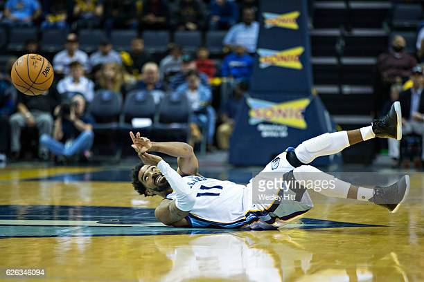 Mike Conley of the Memphis Grizzlies makes a pass from his back during the first half of a game against the Charlotte Hornets at the FedExForum on...