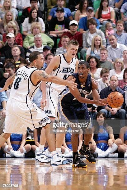 Mike Conley of the Memphis Grizzlies passes around Deron Williams and Andrei Kirilenko of the Utah Jazz during the game on November 10 2007 at...