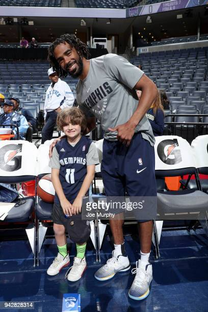 Mike Conley of the Memphis Grizzlies poses with a fan for a photo before the game against the Sacramento Kings on April 6 2018 at FedExForum in...
