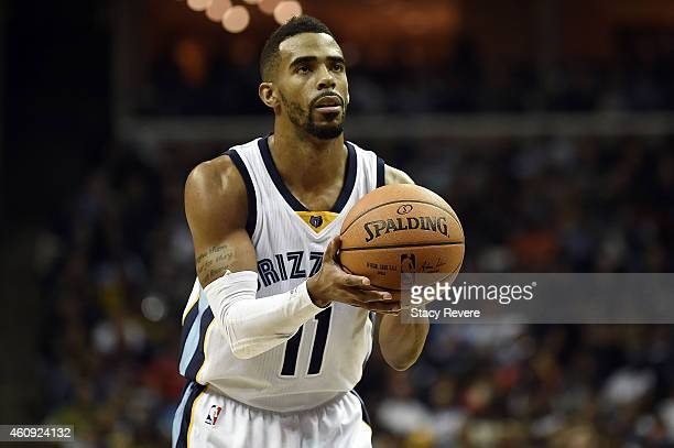 Mike Conley of the Memphis Grizzlies shoots a free throw against the San Antonio Spurs during the third quarter of a game at the FedExForum on...