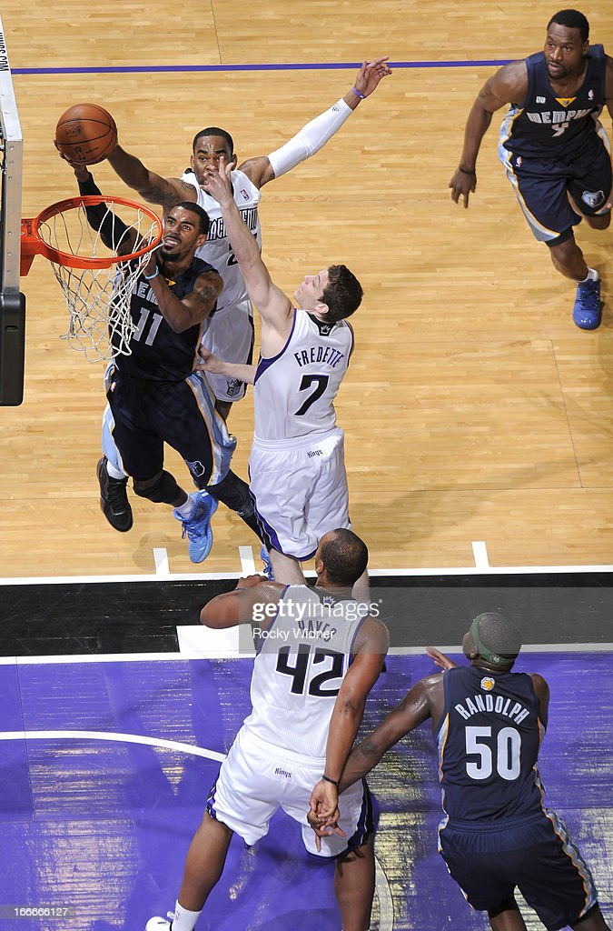 Mike Conley #11 of the Memphis Grizzlies shoots against Marcus Thornton #23 and Jimmer Fredette #7 of the Sacramento Kings on April 7, 2013 at Sleep Train Arena in Sacramento, California.
