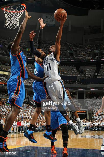 Mike Conley of the Memphis Grizzlies shoots against the Oklahoma City Thunder in Game Three of the Western Conference Semifinals in the 2011 NBA...
